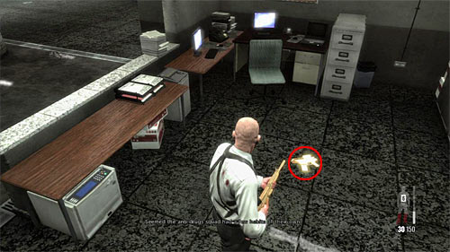 SECRET 10 [Golden Gun - G6 Commando Rifle 2/3]: Behind the desk in small area with elevators and security room - Clues and Golden Guns - Chapter XIII - Collectibles - Max Payne 3 - Game Guide and Walkthrough