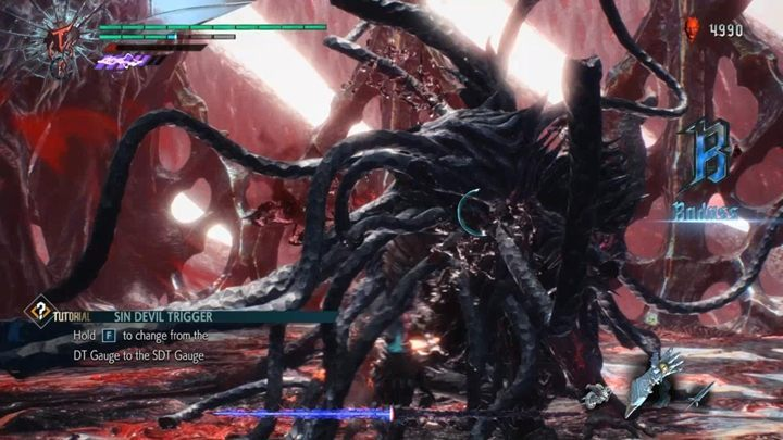 At the beginning of the fight, you are transformed in your stronger form, so use the time to quickly attack Urizen and lower his health as much as you can - Urizen (Mission 12) Boss Fight Guide for DMC5 - Bosses - Devil May Cry 5 Guide