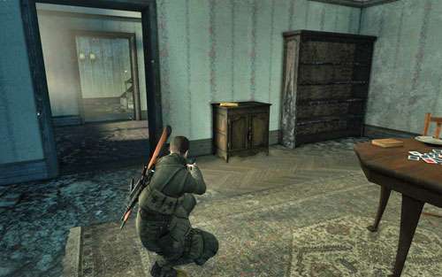 In the first room to the right, inside the building which you have to enter as your first objective [#2] - Mission 3   Wine Bottles and Gold Bars - Wine Bottles and Gold Bars - Sniper Elite V2 Game Guide & Walkthrough