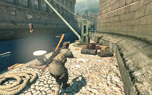 By the crane [#6] right beside the bridge where you have to plant explosives - Mission 3   Wine Bottles and Gold Bars - Wine Bottles and Gold Bars - Sniper Elite V2 Game Guide & Walkthrough