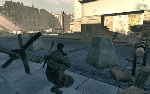 In the left corner of the square, right behind a concrete pillar beside the fenced passage [#6] - Mission 4   Wine Bottles and Gold Bars - Wine Bottles and Gold Bars - Sniper Elite V2 Game Guide & Walkthrough