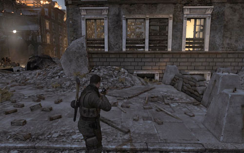 After destroying the first tank, turn into the street on the left - the Gold Bar can be found by the barricade [#1] - Mission 5   Wine Bottles and Gold Bars - Wine Bottles and Gold Bars - Sniper Elite V2 Game Guide & Walkthrough