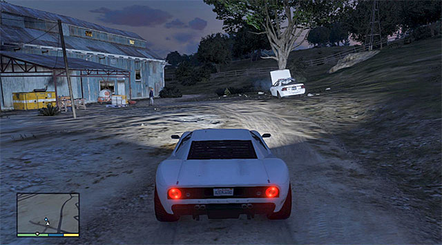 The inmate standing at the demolished police car - Prisoner lift - 1 - Random events - Grand Theft Auto V Game Guide