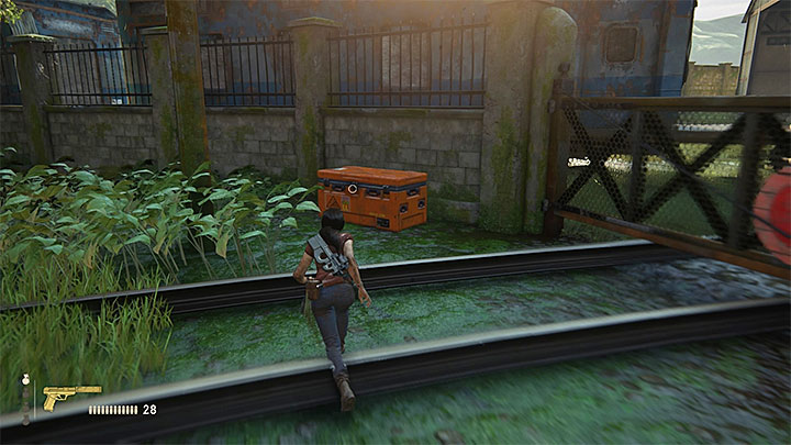 The second accessible chest is located at the other end of the trainyard, next to a large wall and a locked gate (screenshot above) - Right Under Your Nose | Trophy Guide - Trophy Guide - Uncharted: The Lost Legacy Game Guide