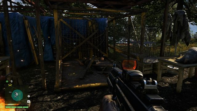You will find the mask in the corner of a cage near the campfire - Southern and central Kyrat - Yalungas Masks - Far Cry 4 - Game Guide and Walkthrough