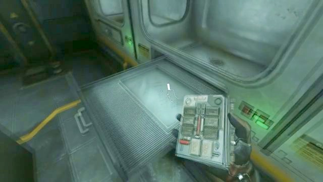 Place the chip on the drawer and then push it inside. - Omicron station | Riddles and puzzles of SOMA Game - Riddles and puzzles - SOMA Guide
